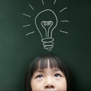 Child with light bulb thought