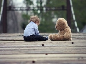 Child and teddy bear